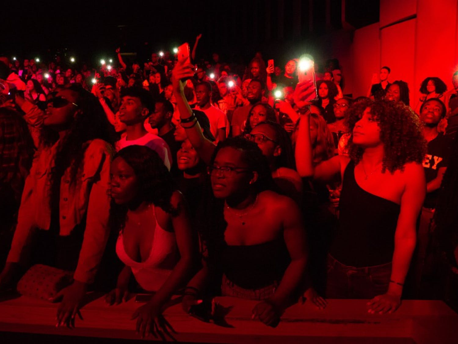 Audience members light up their phones as they sing along to Kranium.