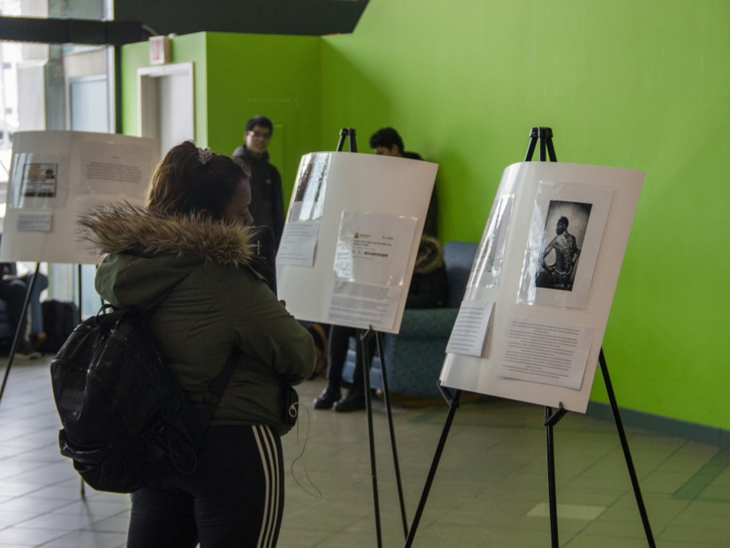 Students walk through the Student Association's museum for Black History Month in the SU lobby. The Black Student Union, African Student Association and SA are trying to spread awareness for Black History Month.