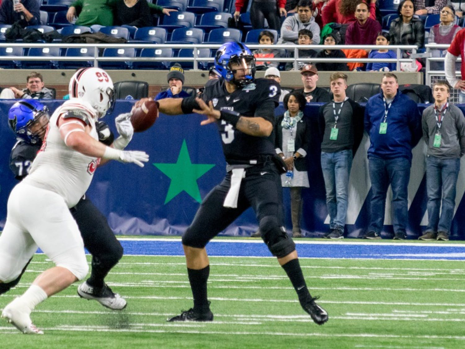Tyree Jackson drops back to throw at the 2018 Mid-American Conference Championship Game. Jackson's pro day was modeled after Bills quarterback Josh Allen.