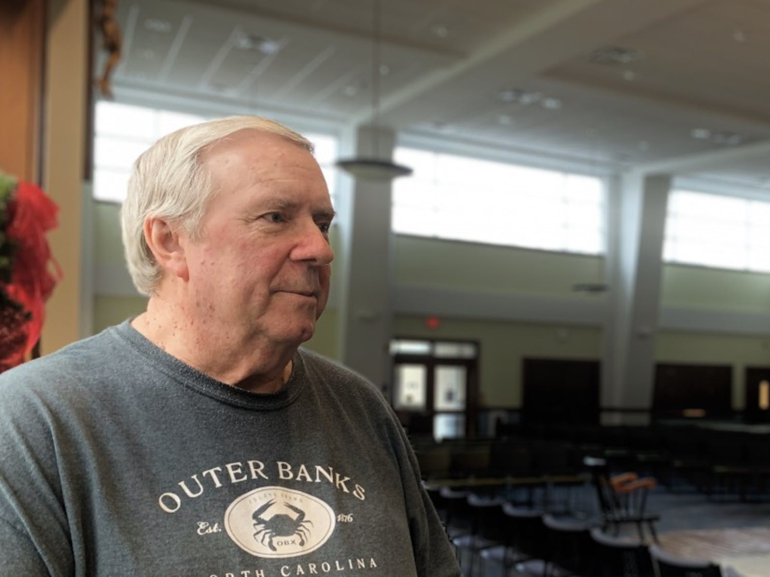 Father Roy Herberger stands in the congregation space at the Newman Center. Herberger recently returned from a suspension from the Buffalo Diocese after being exonerated from a sexual abuse complaint.