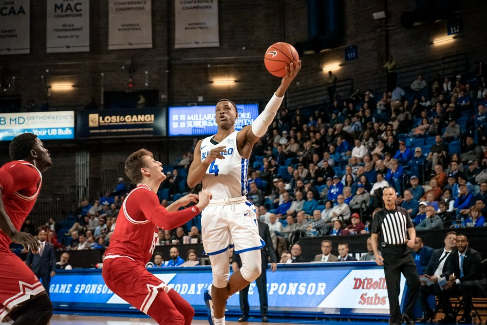 <p>Senior guard Davonta Jordan driving to the basket for 2 of his 11 points.</p>
