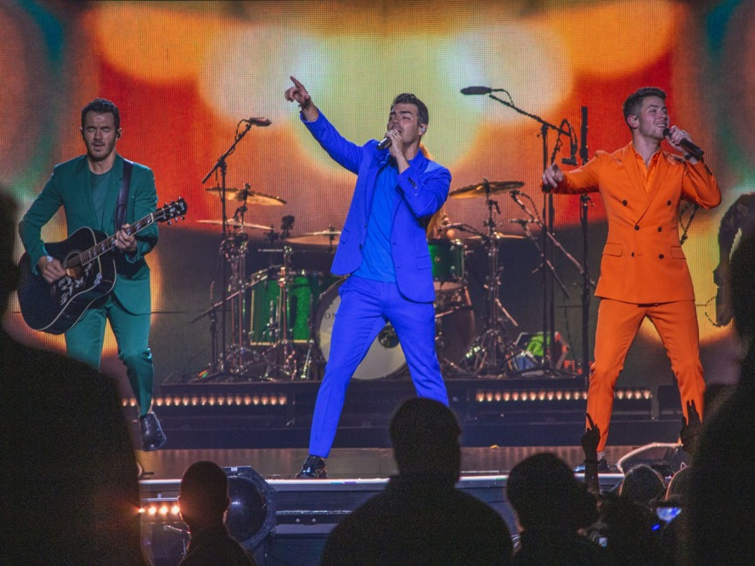 The Jonas Brother lit up the stage in vibrant colors while they entertained the crowd at the KeyBank Center Tuesday night. From left to right: Kevin Jonas, Joe Jonas and Nick Jonas.