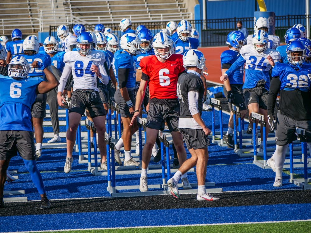 <p>UB football held its first spring practice Monday. Quarterback Casey Case (6) and tight end Jackson Westfall (84) look to make an impact for the Bulls this season.</p>
