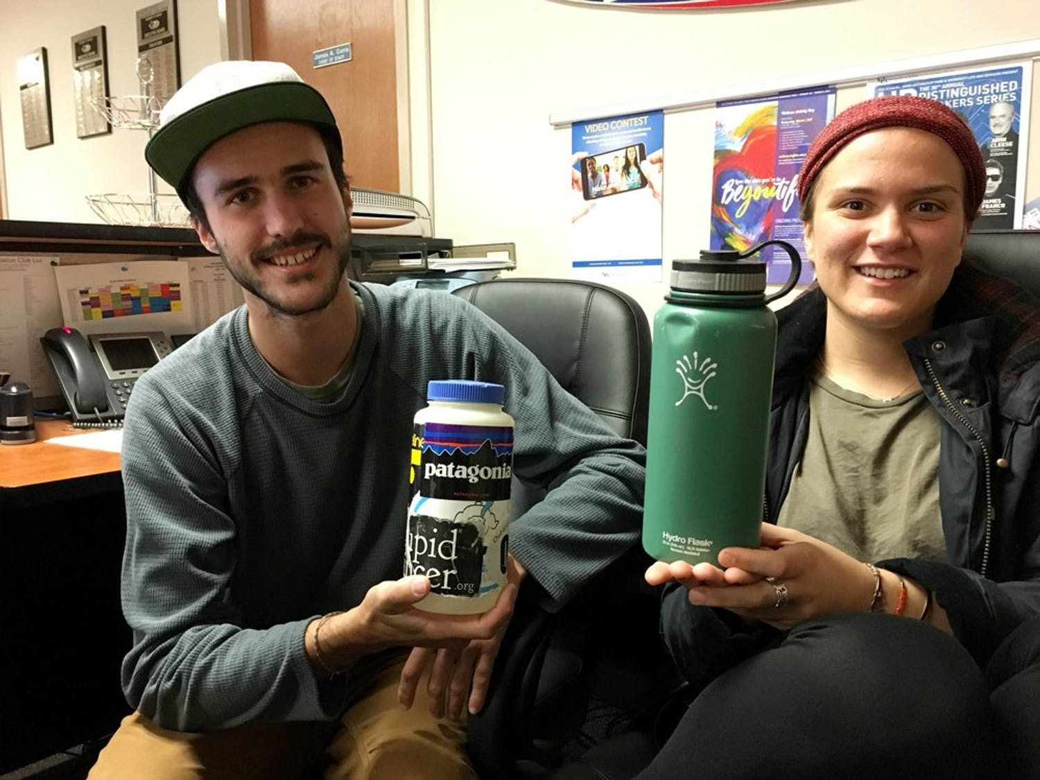 Brian Johnson and Anna Heintzman are members of UB's Outdoor Adventure Club. Johnson and Heintzman take pride in personalizing their reusable water bottles.