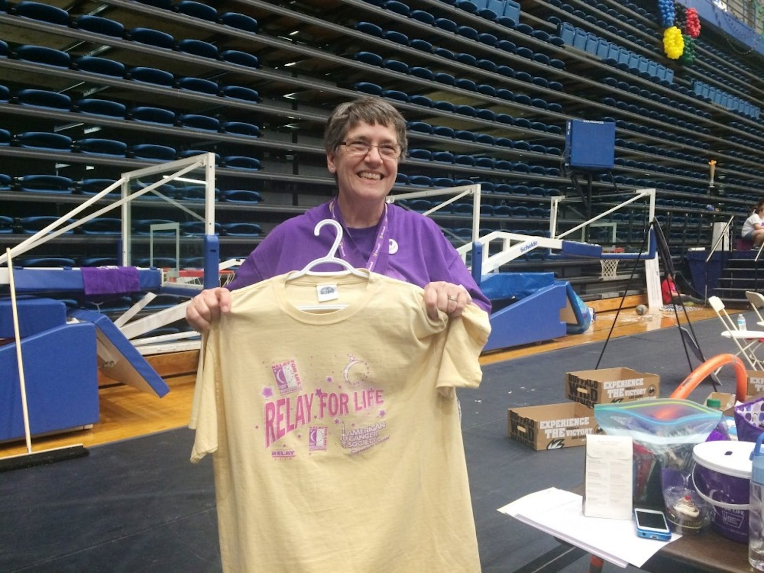 Survivor, teammate, committee member and honored guest Pricilla Snider displays the Relay for Life t-shirt from 1997.