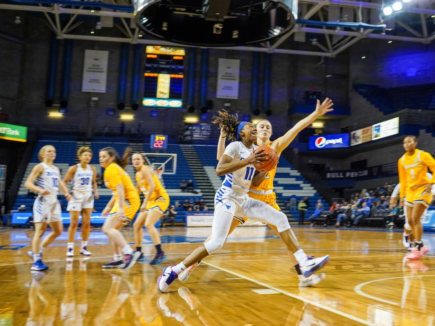 Senior Guard Theresa Onwuka goes in for a shot during the game against Kent State in the Alumni Arena on Saturday.