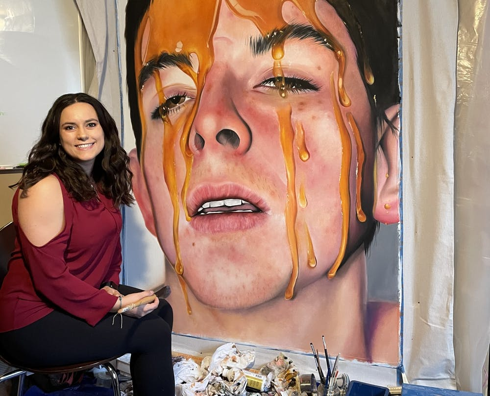 Gianna Damico says she prefers oil paints and likes to create works that are big and colorful.