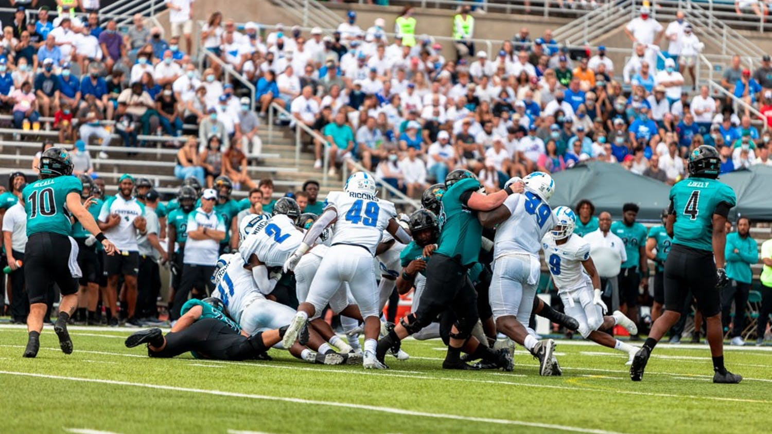 Despite a valiant effort against one of the top teams in the nation, Coastal Carolina's highly efficient multiple offense scheme proved to be too much for the Bulls on Saturday.