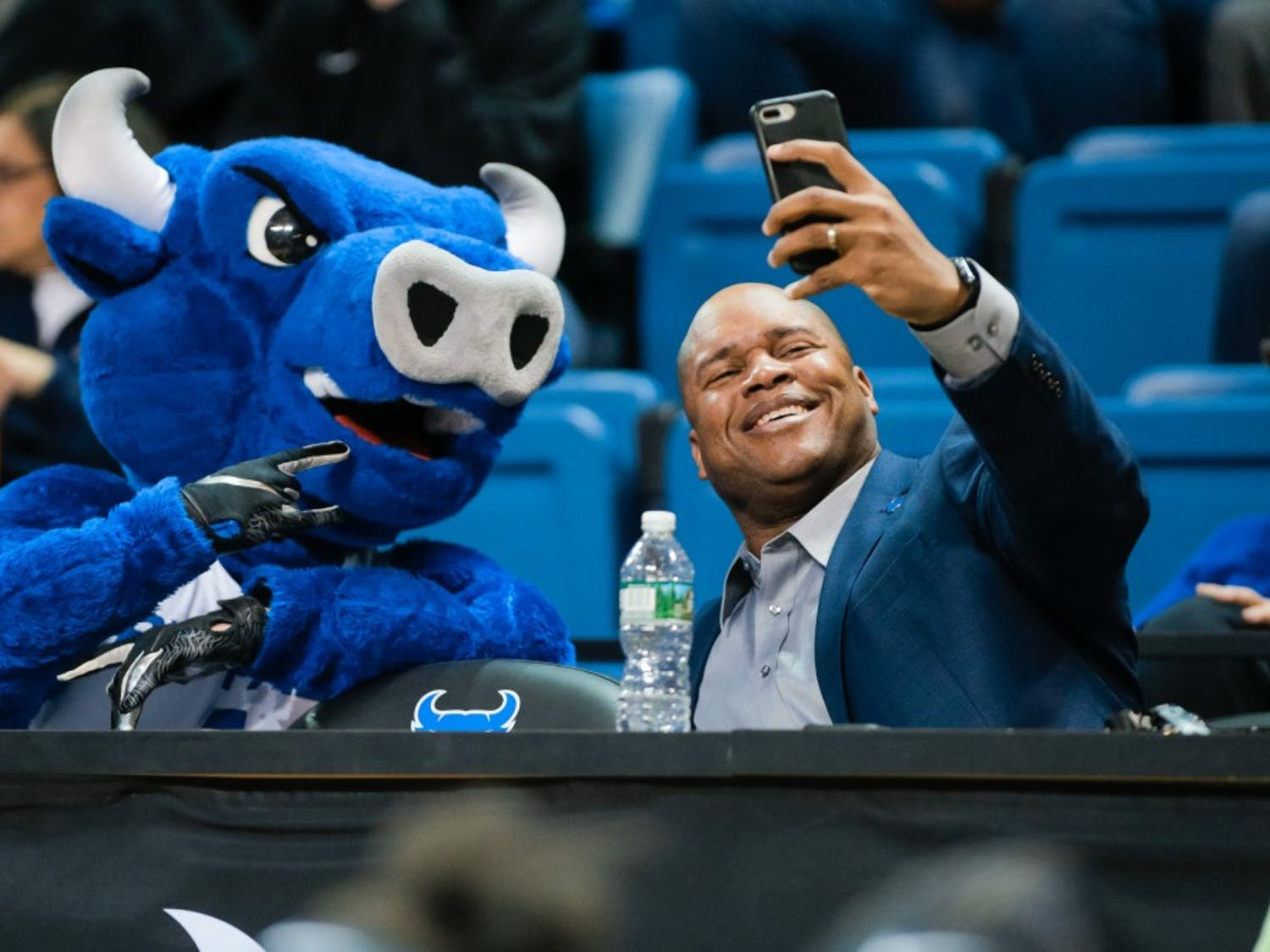 Athletic Director Mark Alnutt takes a selfie with UB's mascot Victor E. Bull at a basketball game. Alnutt hopes to continue the success of UB Athletics he inherited when taking the job.