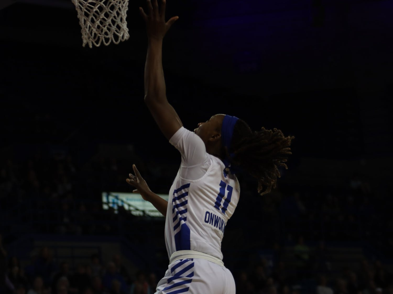 Senior guard Theresa Onwuka goes for a successful layup at Wednesday's game against Central Michigan after a successful steal.