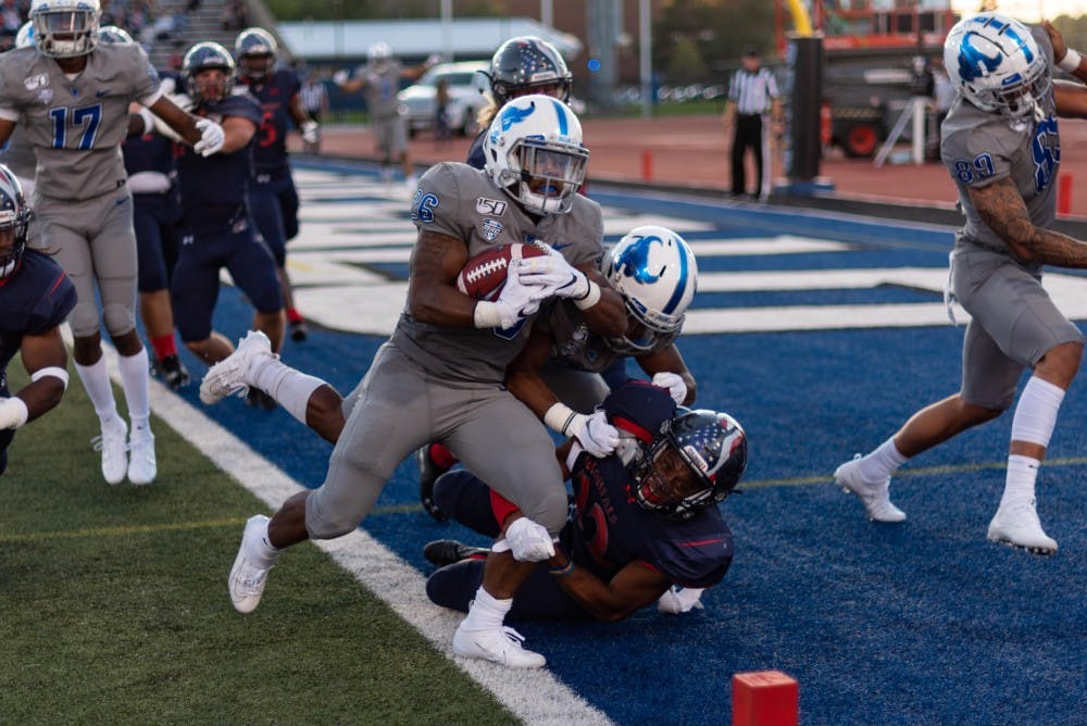 <p>UB running back Jaret Patterson takes one to the end zone last season as the Bulls defeated Robert Morris 38-10.</p>