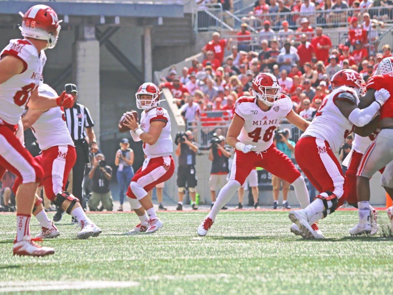 Freshman Quarterback Brett Gabbert looks toward redshirt senior wide receiver Luke Mayock. Gabbert is questionable for this week's game.