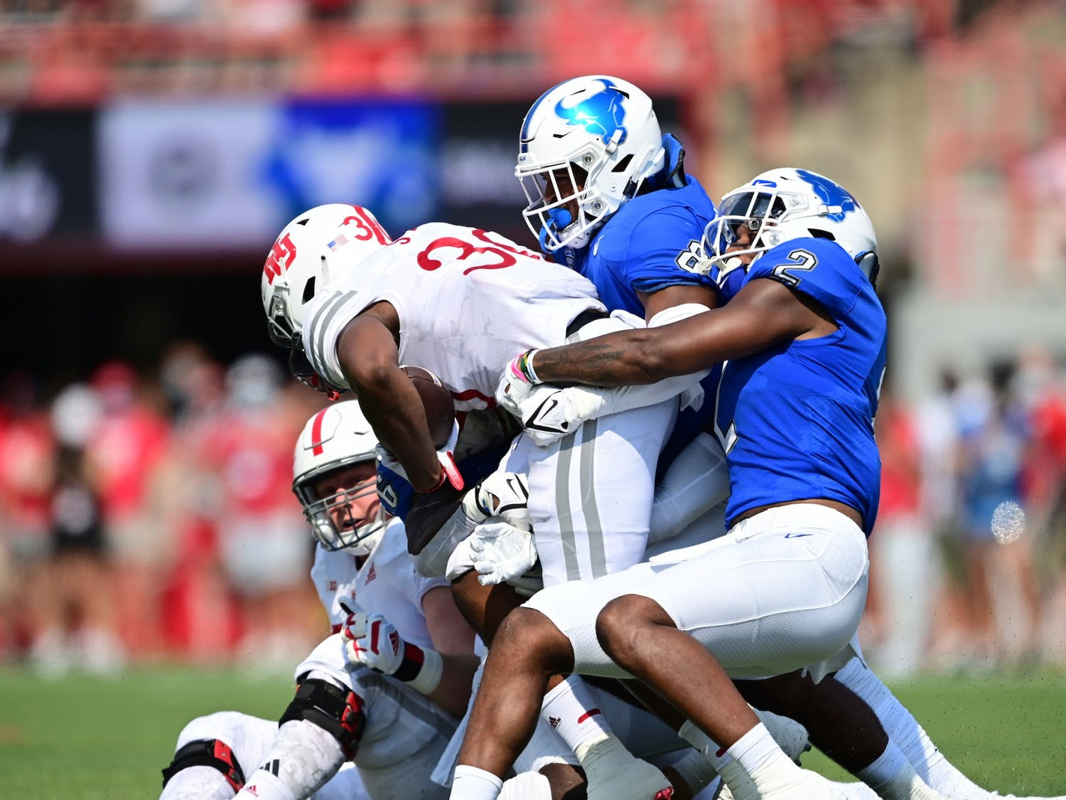 Linebackers Kadofi Wright (2) and James Patterson (8) combine for a tackle in UB's 28-3 loss to Nebraska Saturday.