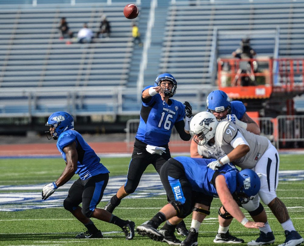 <p>Former UB quarterback Joe Licata throws against the Nevada Wolfpack. Licata opened up Joe Licata Football to develop high school athletes in Western New York.</p>