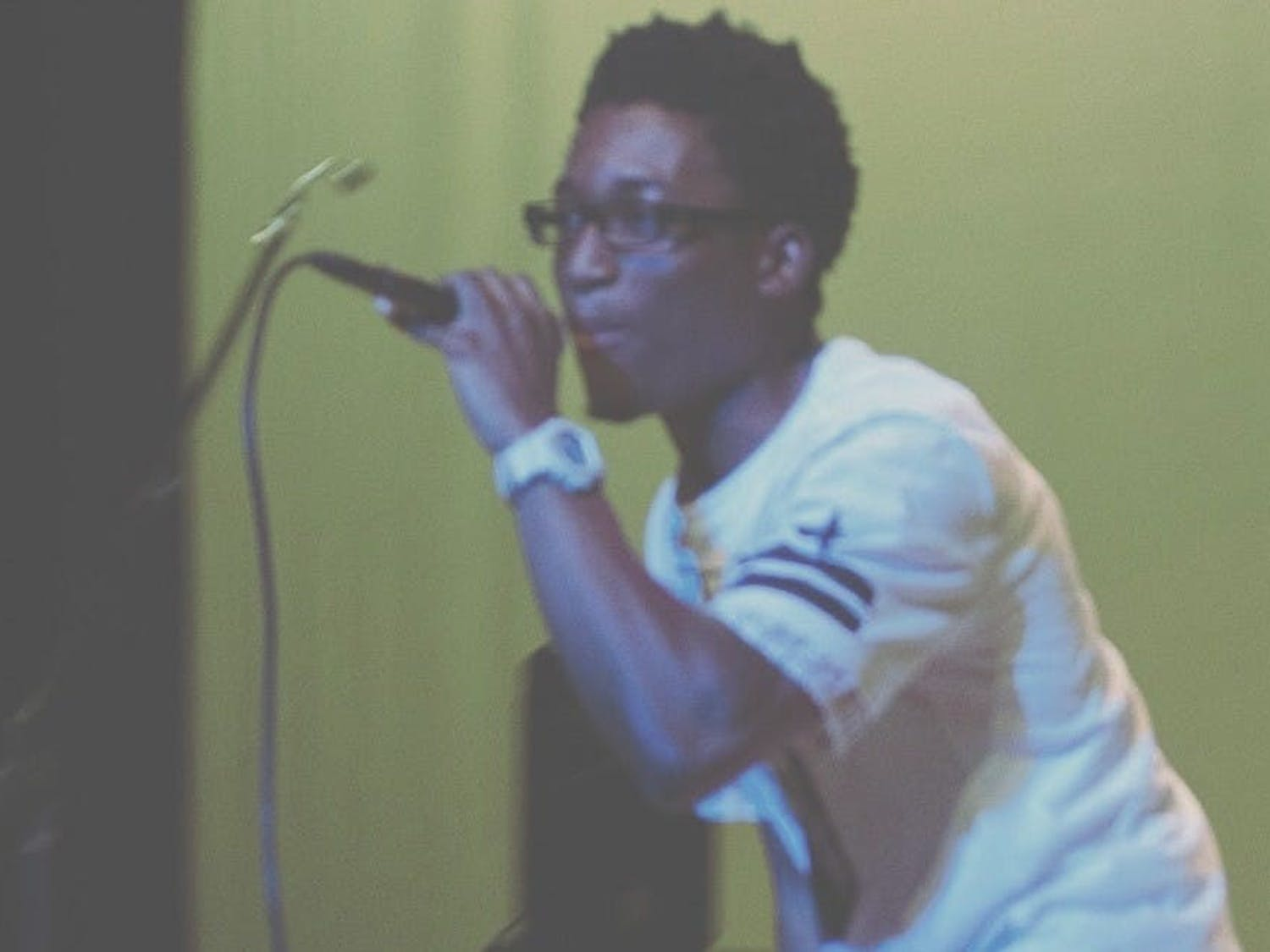 Student rapper Marc Mighty performs at a show.
