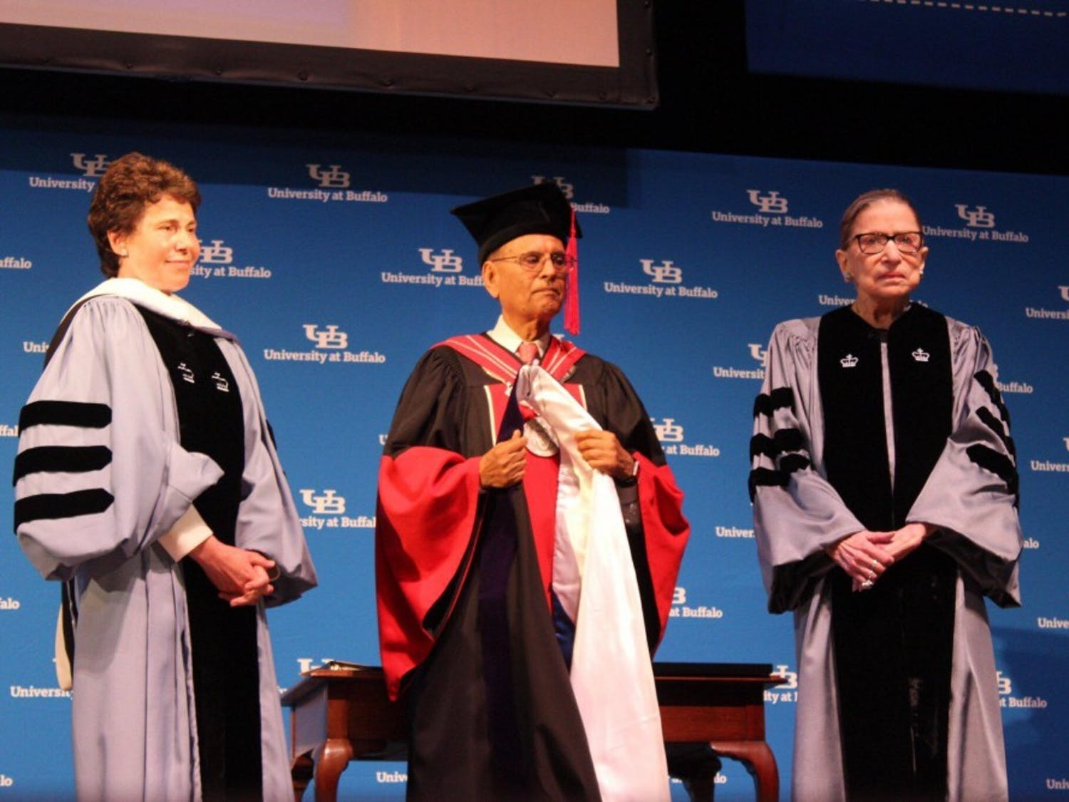 Associate Justice of the Supreme Court Ruth Bader Ginsburg (right) stands next to UB President Satish Tripathi and Acting Chairman of the SUNY Board of Trustees Merryl Tisch as she receives her honorary diploma from UB.