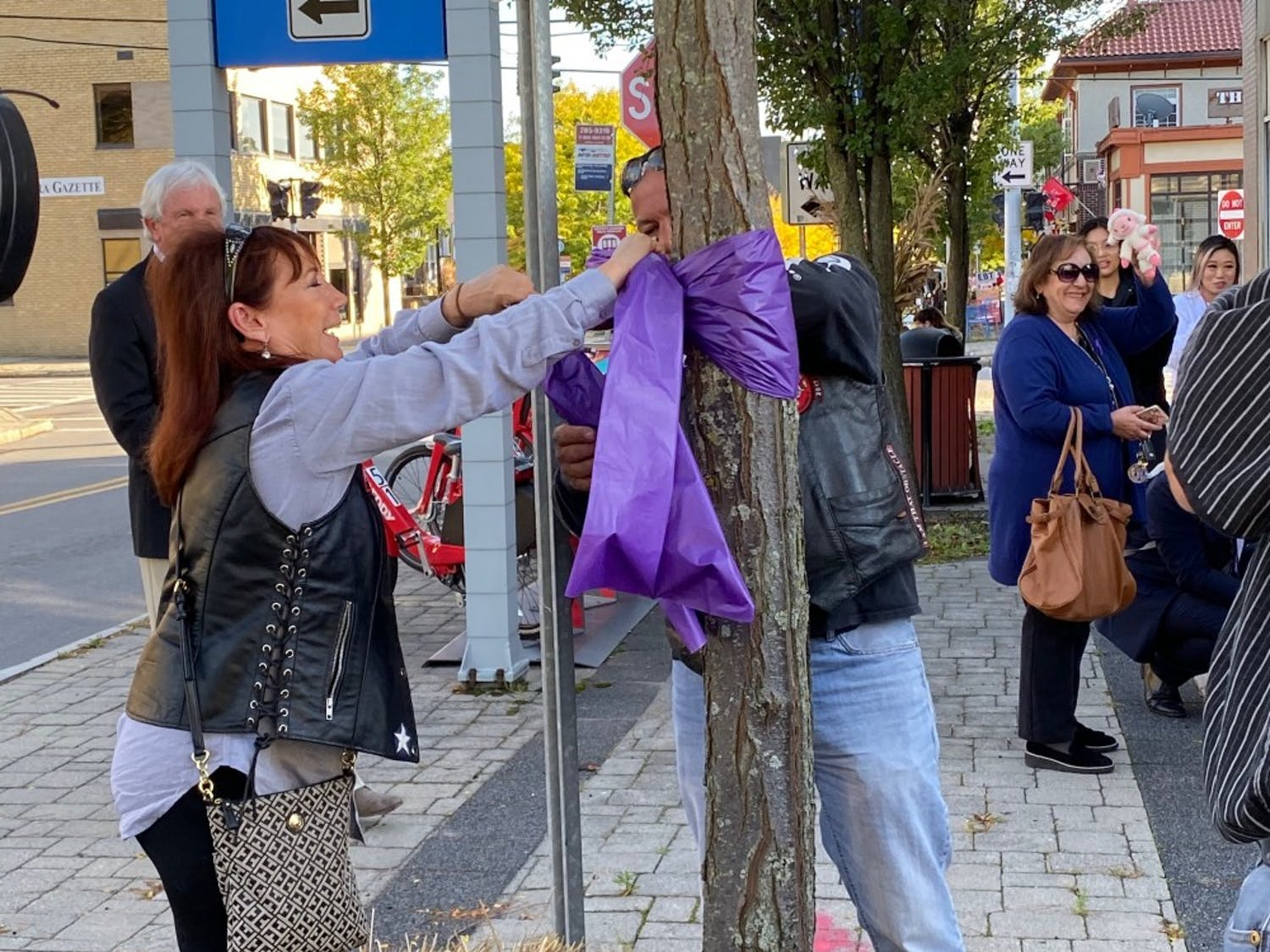 Buffalo community members tied purple ribbons to show resilience for domestic abuse survivors.
