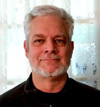 Middle-aged_man_with_gray_hair_and_beard.jpg