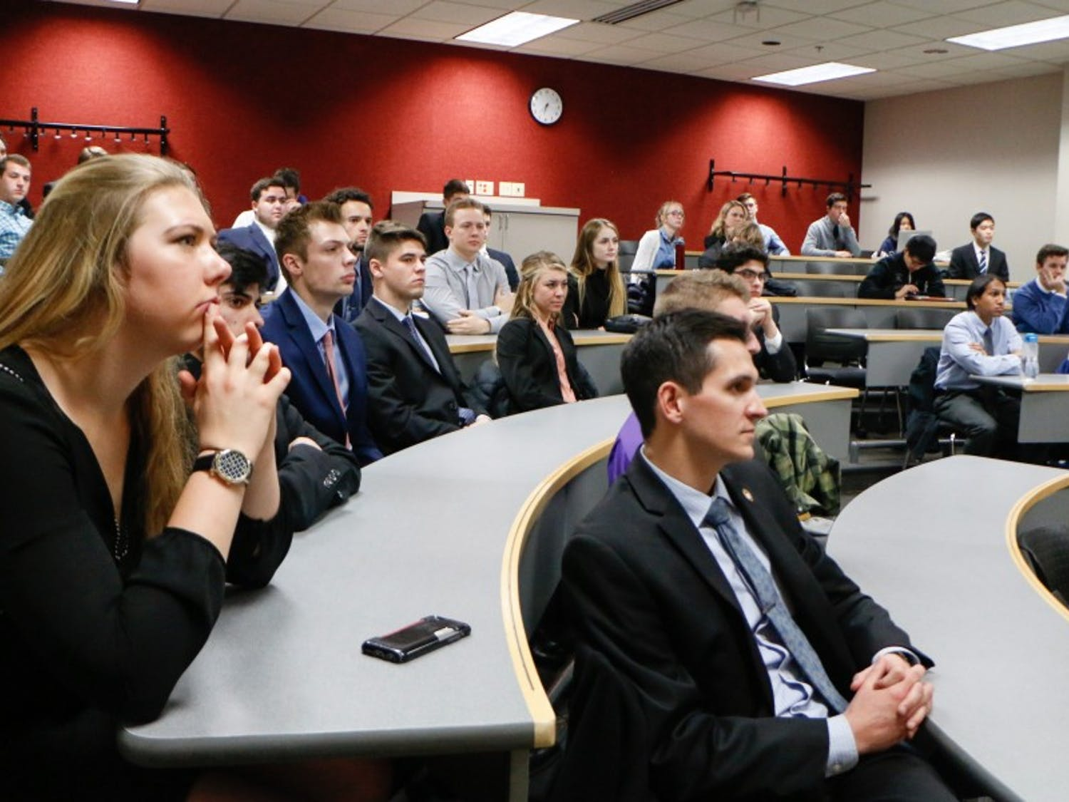 Students attend a Badger Consulting meeting, where they work with local businesses to improve their professional skills.