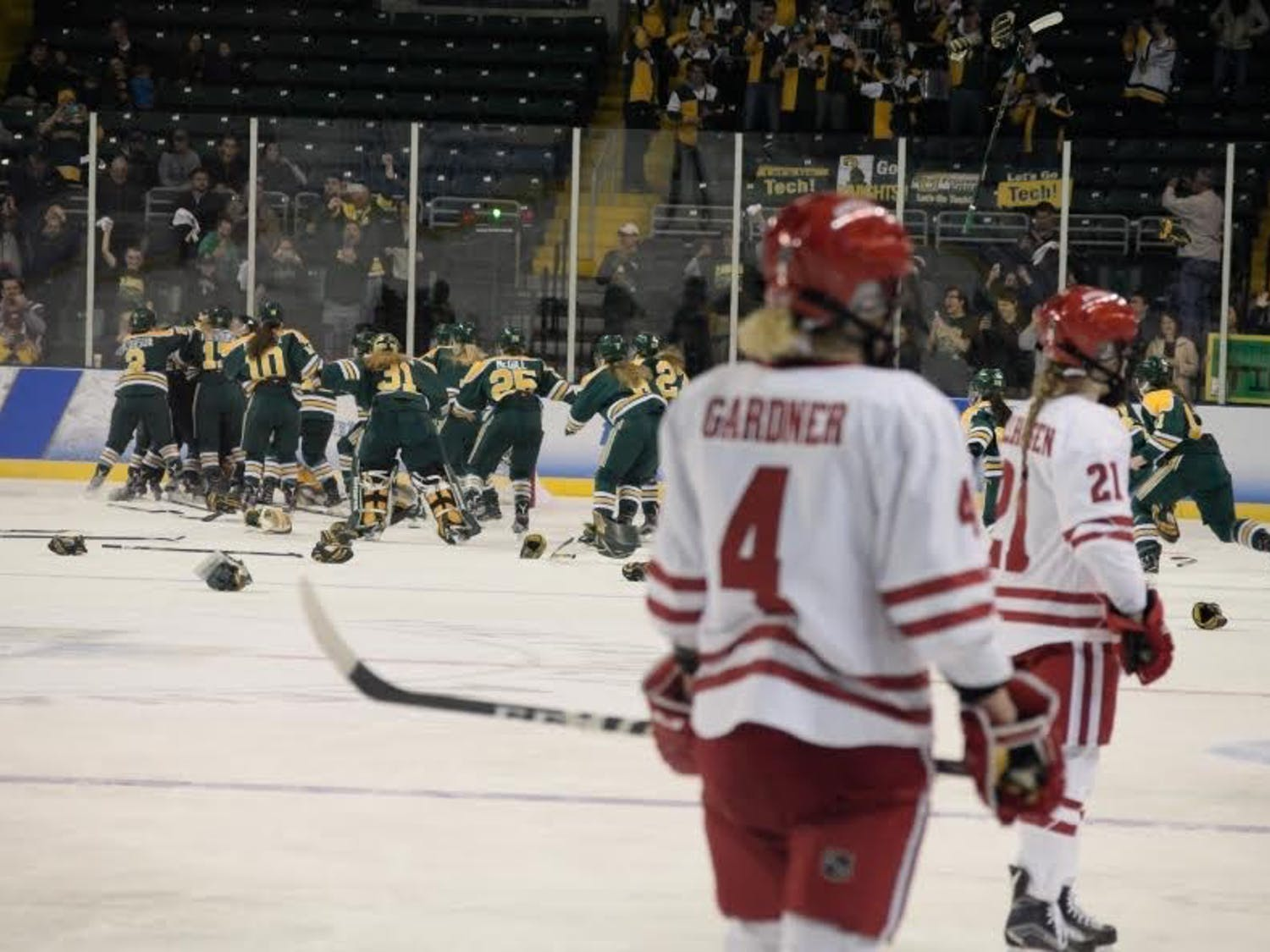 The Wisconsin Badgers fell one win short of capturing their fifth national title in program history.The Clarkson Knights celebrate their championship in the background as the horn sounds.