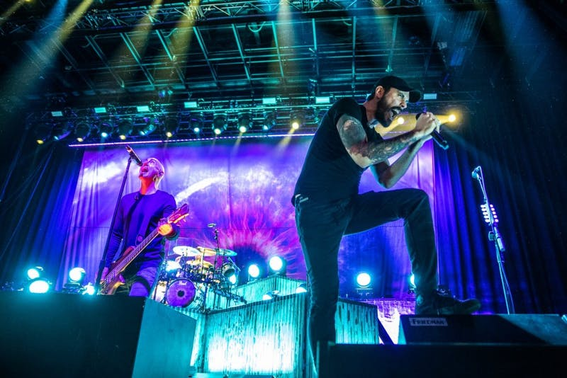 Ben Burnley (right) and bass guitarist Aaron Bruch (left) put on a colorful, blazing display at the Sylvee on March 25 with the rest of their band Breaking Benjamin. Skillet, Underoath and Fight the Fury also performed.
