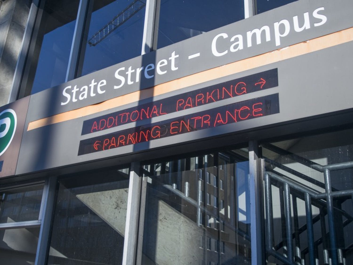 Police apprehended a suspect early Friday morning after he reportedly fired a shot in a downtown parking garage.