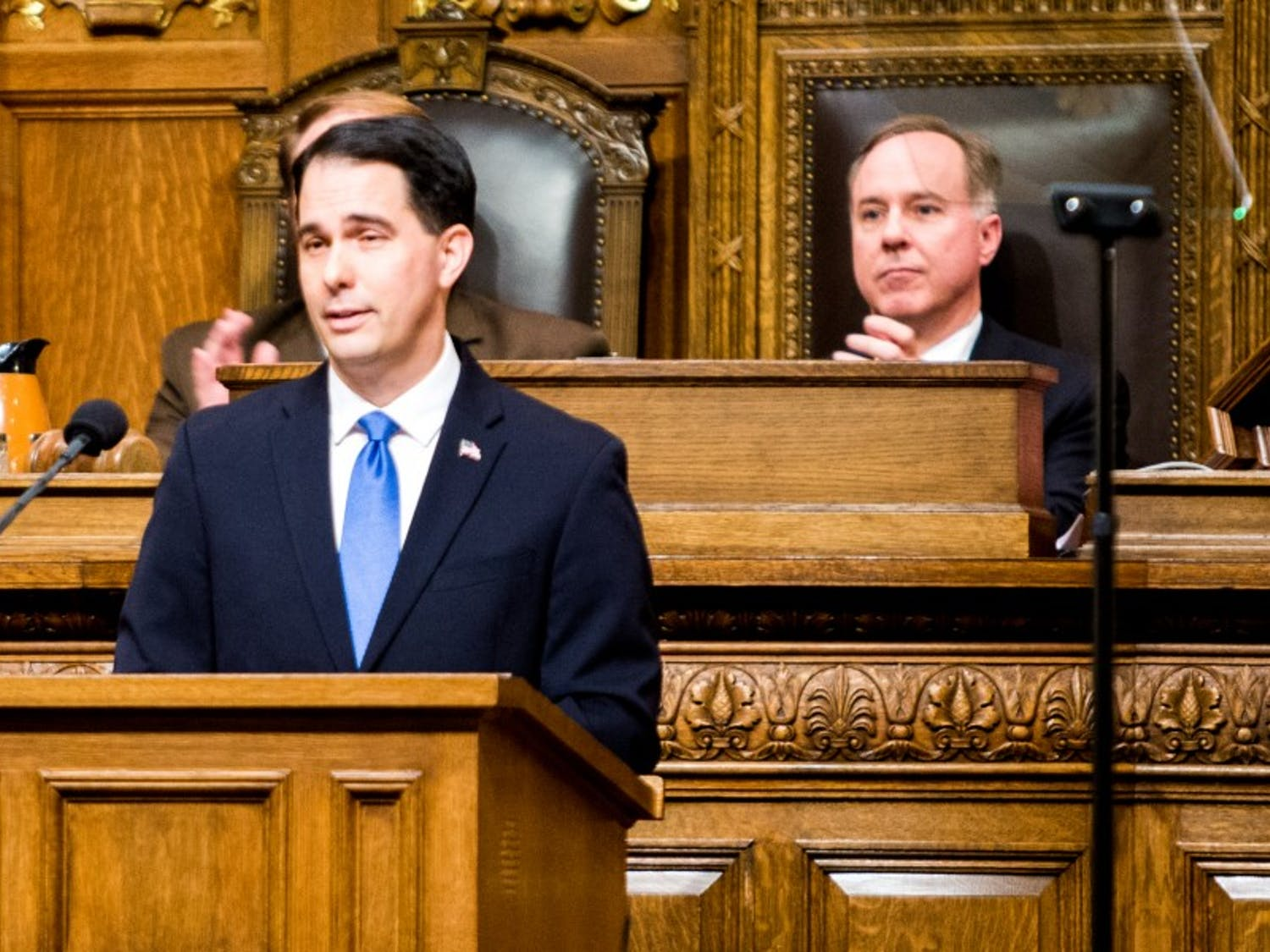 Gov. Scott Walker and Assembly Speaker Robin Vos, R-Rochester, disagree over whether to raise gas taxes and vehicle fees or borrow a half billion dollars for road and highway projects.