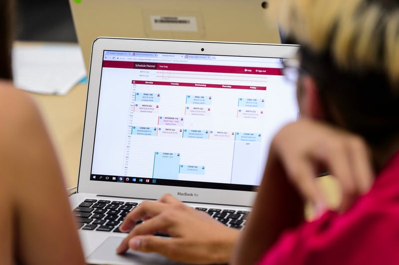At right, a College of Engineering student-peer advisor works with an incoming first-year undergraduate to register for her classes using a laptop computer during a Student Orientation, Advising and Registration (SOAR) session at College Library in Helen C. White Hall at the University of Wisconsin-Madison on Aug. 9, 2017. Sponsored by the Center for the First-Year Experience, the two-day SOAR sessions provide new students and their parents and guests an opportunity to meet with staff and advisors, register for classes, stay in a residence hall, take a campus tour and learn about campus resources. (Photo by Jeff Miller / UW-Madison)