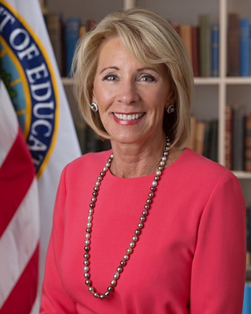 U.S. Education Secretary Betsy DeVos announced Thursday that her department will rewrite and replace federal sex discrimination laws to change how universities handle sexual assault investigations.