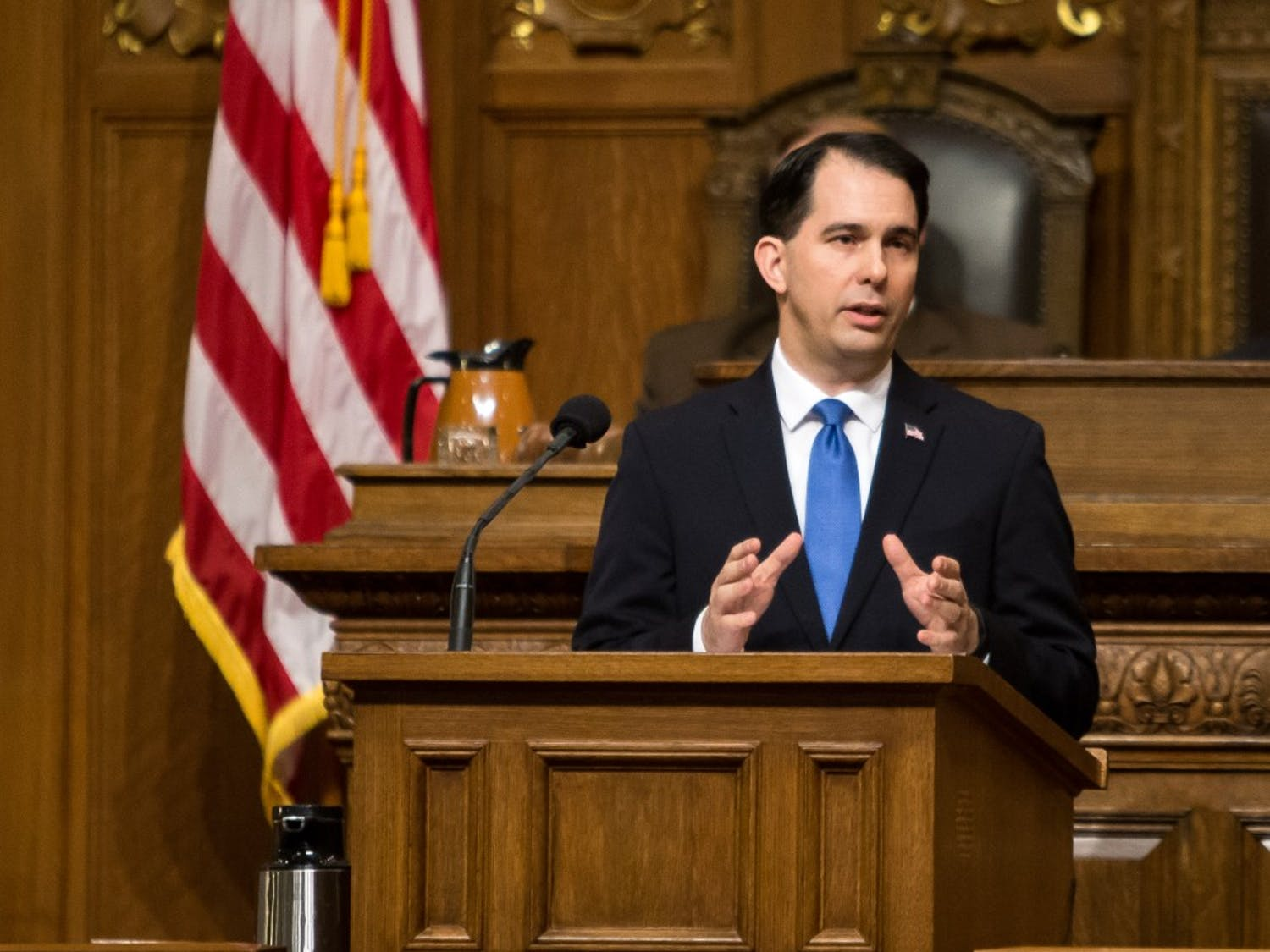 Gov. Scott Walker signed a pair of bills into law Thursday cutting funding for Planned Parenthood by roughly $8 million.