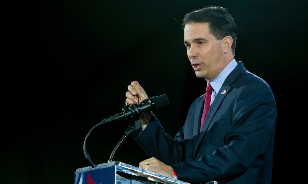 <p>Gov. Scott Walker announced part of his state budget proposal Tuesday, which includes a 5 percent tuition cut for all in-state UW System undergrads.</p>