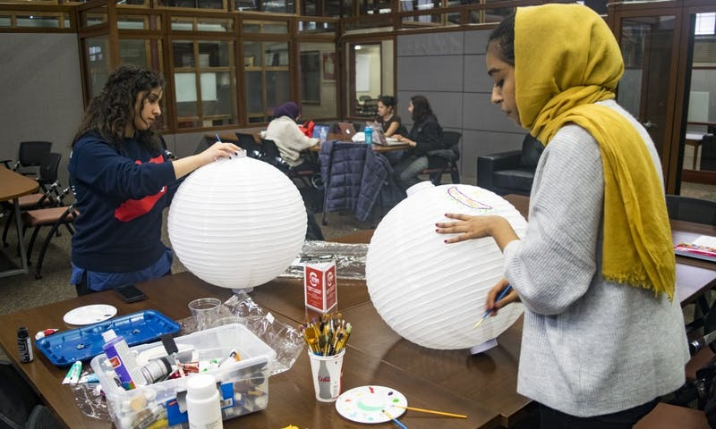 Students make lanterns in preparation for the Night Festival Wednesday at 5:30 p.m. in the Multicultural Student Center.