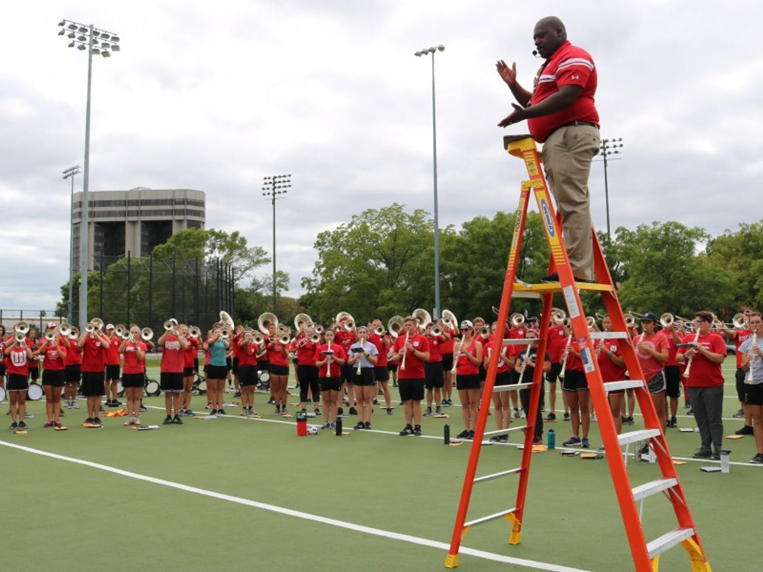 Corey Pompey and UW Marching Band members practice for the upcoming season.