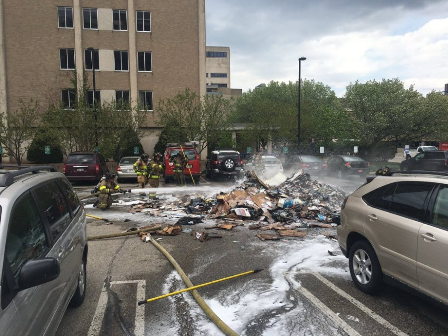 The Madison Fire Department extinguishes a pile of garbage Monday after an Advanced Disposal truck started on fire.