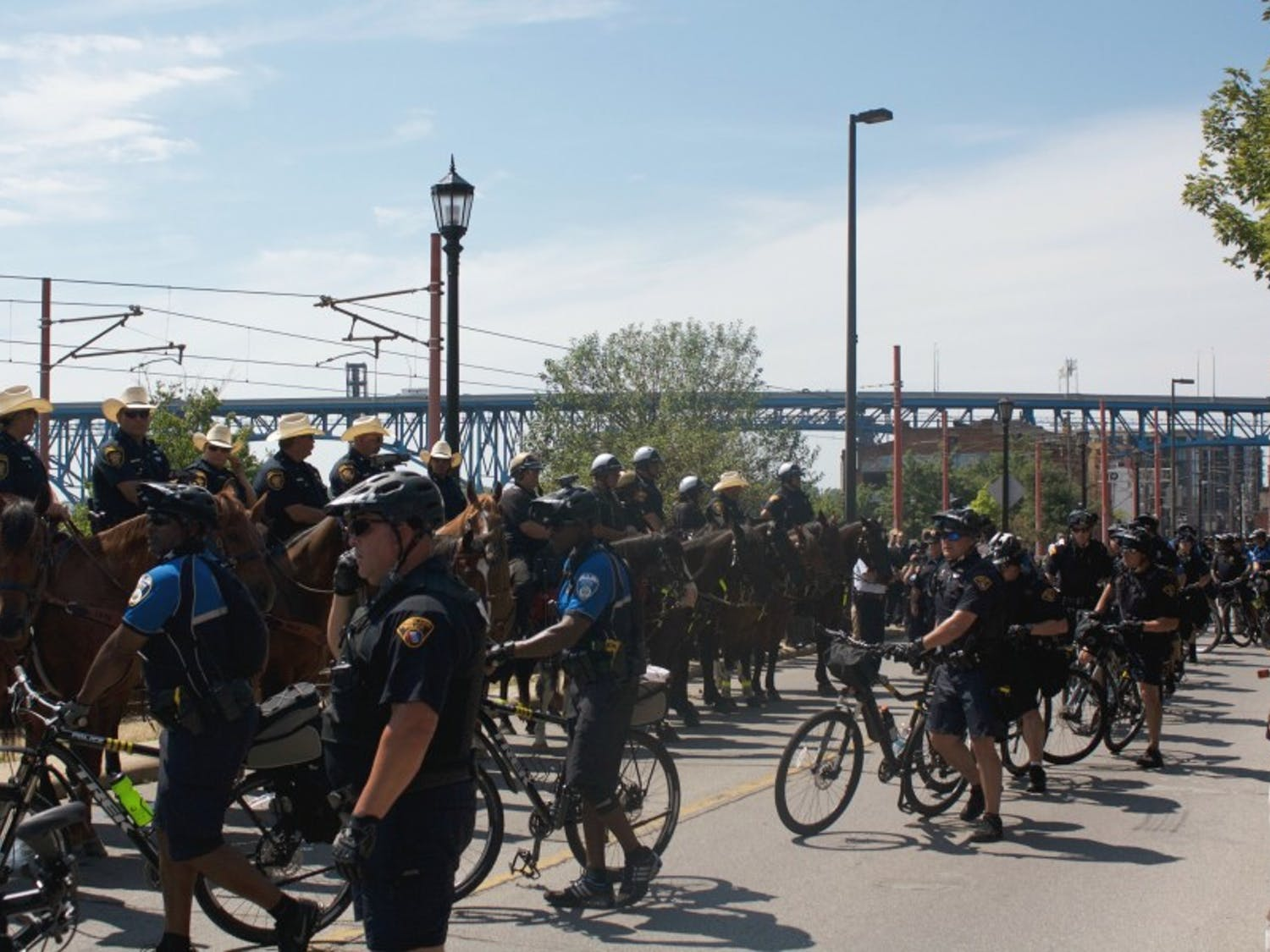 Local, state and federal law enforcement officials had to separate two groups of protesters after an argument broke out in downtown Cleveland just outside the Republican National Convention.