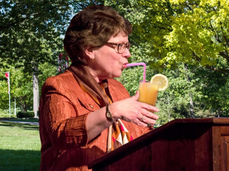 UW-Madison Chancellor Rebecca Blank sips lemonade as she sells baked goods on Bascom Hill.