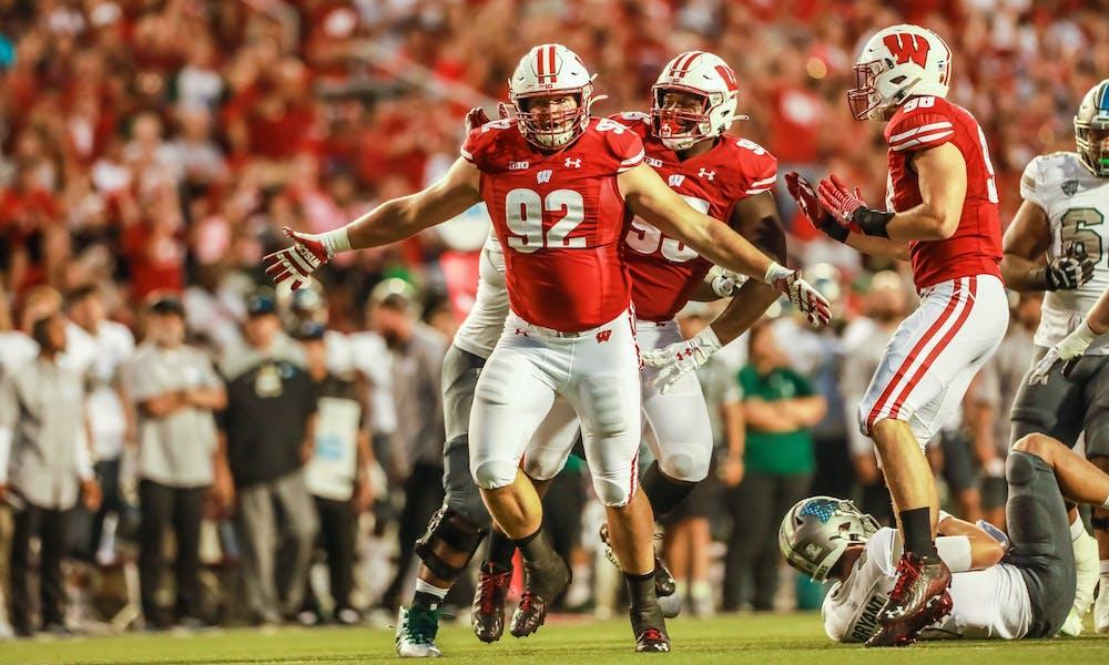 Photo of football player Matt Henningsen celebrating after a play.