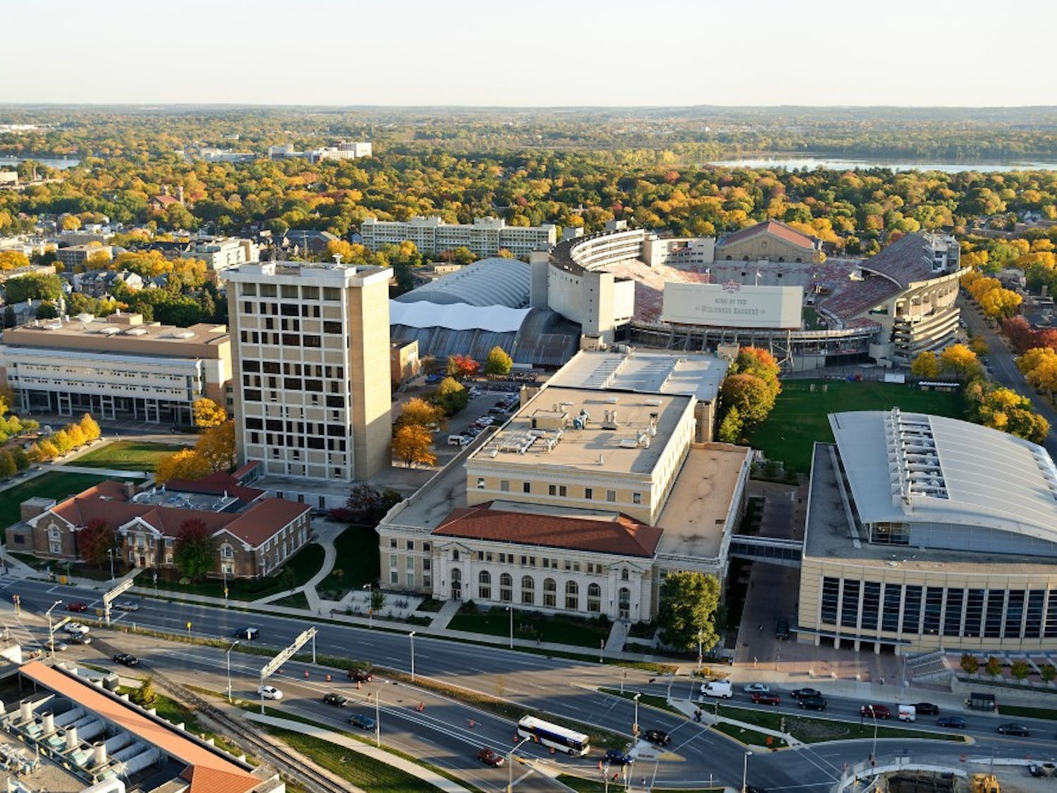 The engineering campus at the University of Wisconsin-Madison is pictured in an aerial view during an autumn sunset on Oct. 5, 2011. Clockwise from bottom right is the Engineering Centers Building, Mechanical Engineering Building, Material Science and Engineering Building, Engineering Hall, and Engineering Research Building. In the background is Camp Randall Stadium. The photograph was made from a helicopter looking south. (Photo by Jeff Miller/UW-Madison)