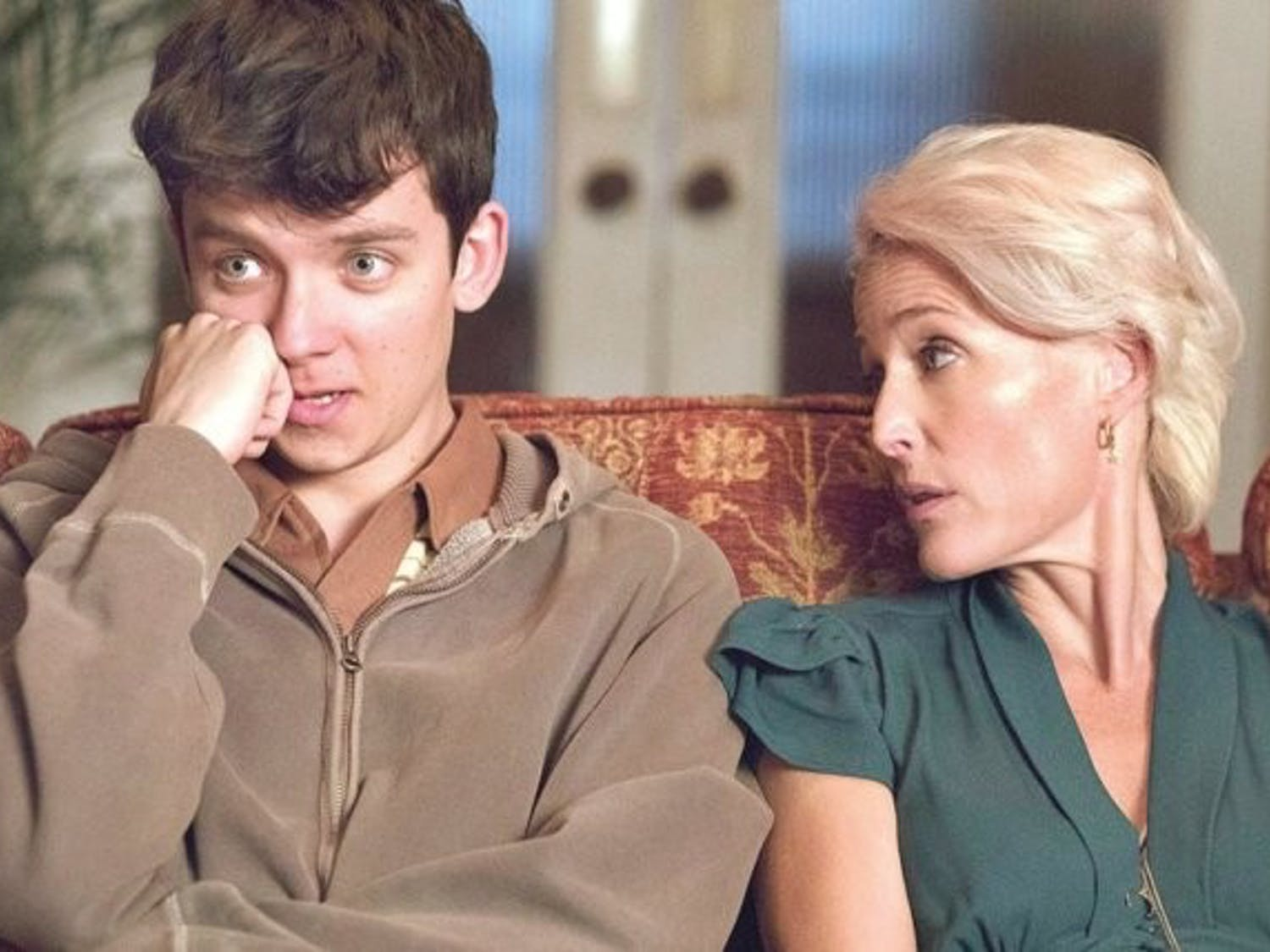 "Asa Butterfield and Gillian Anderson star in ""Sex Education."""