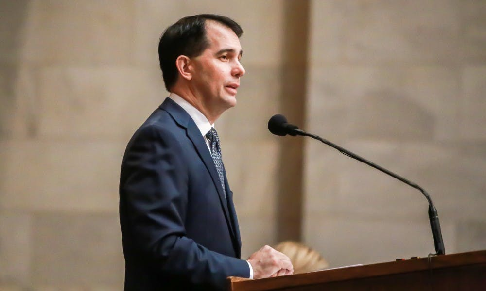 Gov. Scott Walker said he will cut tuition for in-state students at UW System schools.