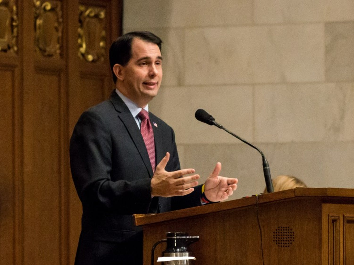 Gov. Scott Walker signed a bill into law Saturday extending the concealed carry law to protect switchblades.