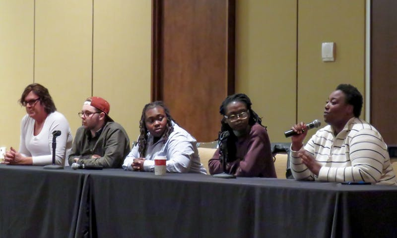 Transgender and gender non-conforming students and community members discuss their experiences on campus at a panel held at Union South Wednesday night.
