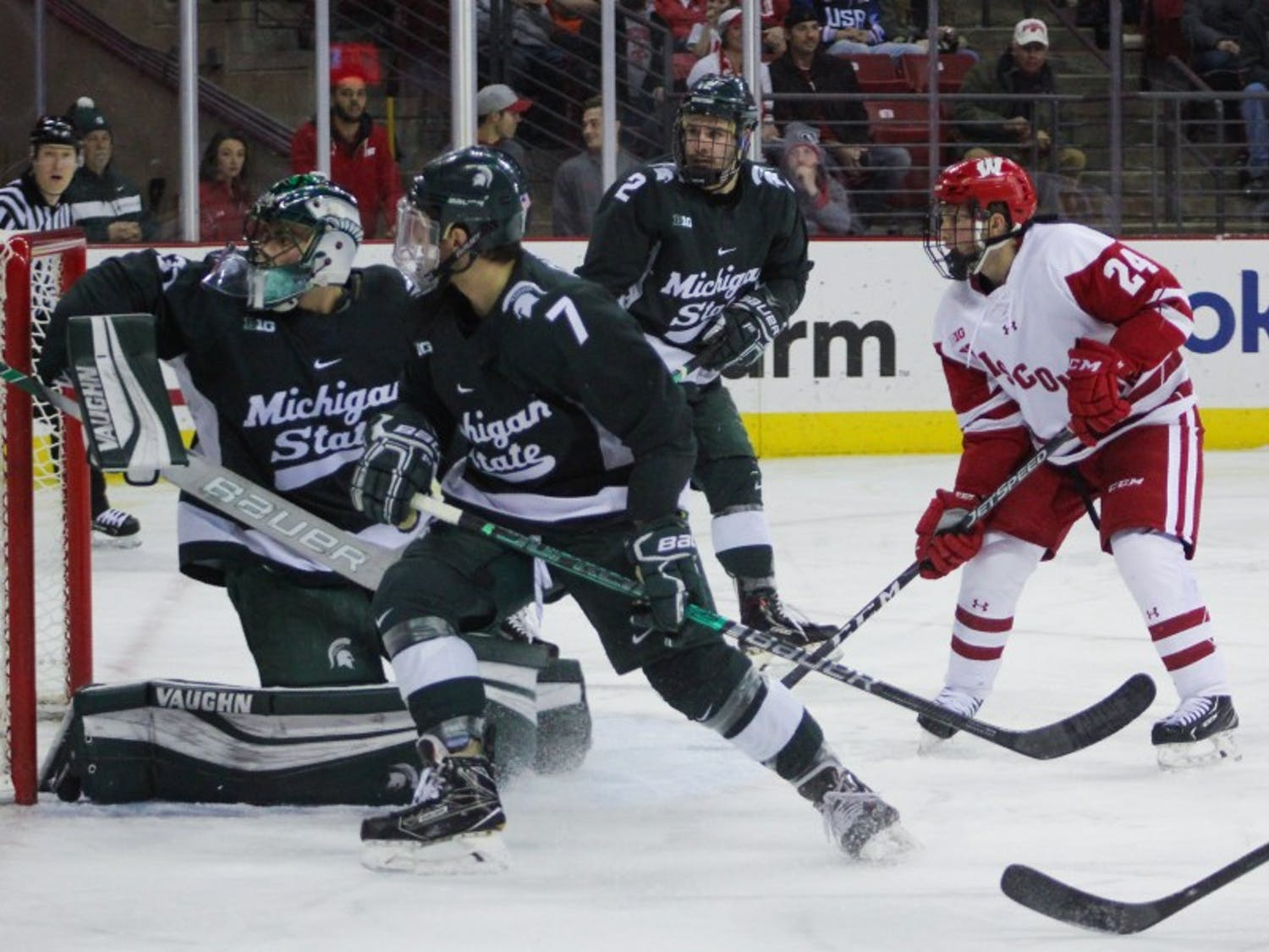 Sophomore forward Sean Dhooghe scored two goals, the second with just 26.2 seconds remaining in overtime, to give Wisconsin a needed three points in the Big Ten standings