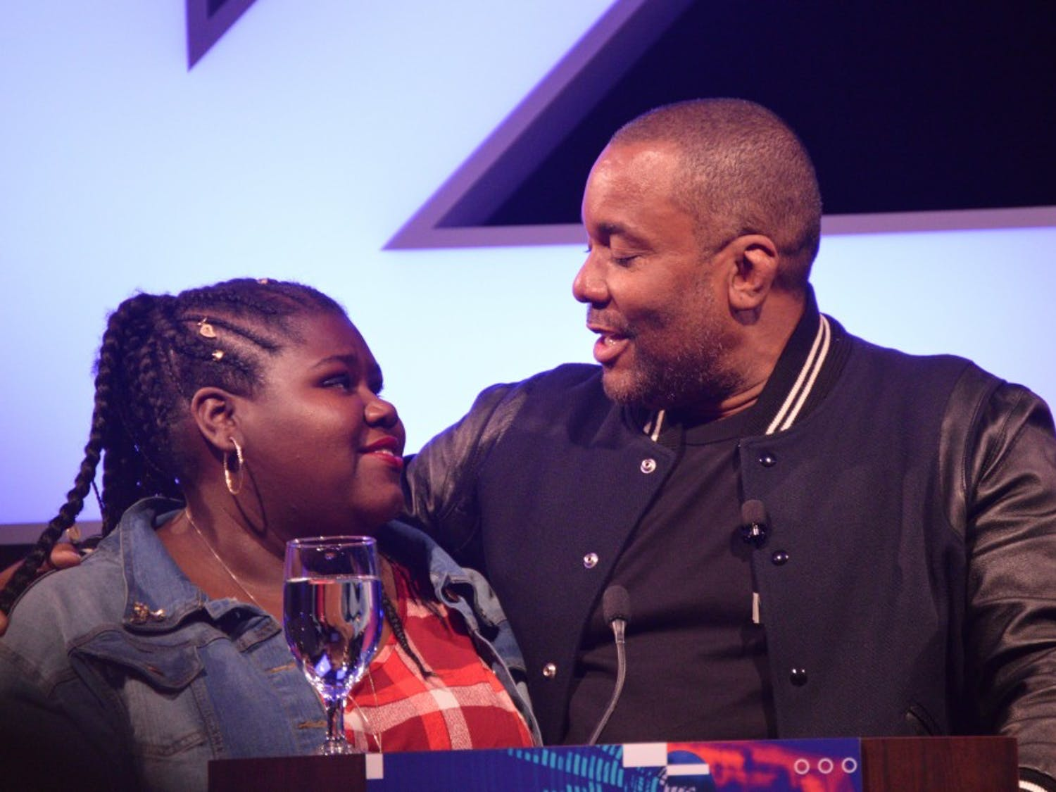 """Actress Gabourey Sidibe of """"Precious""""joins Lee Daniels onstage for an emotional reunion."""