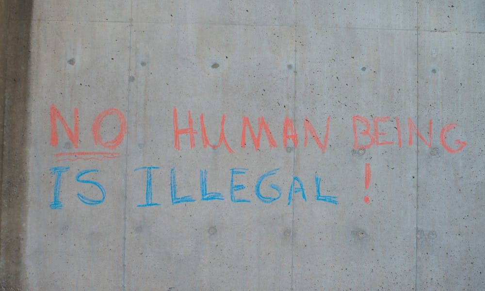 Writing in chalk was recently found on Mosse Humanities Building that sends the same message as the letter calling for UW-Madison to protect undocumented people.
