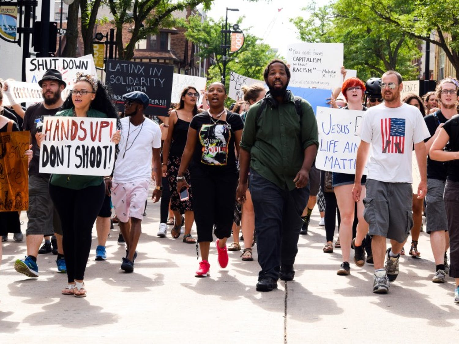 Supporters of the Black Lives Matter movement marched down State Street and around Capitol Square Sunday in response to the recent shootings in Baton Rouge, La., suburban St. Paul and Dallas.