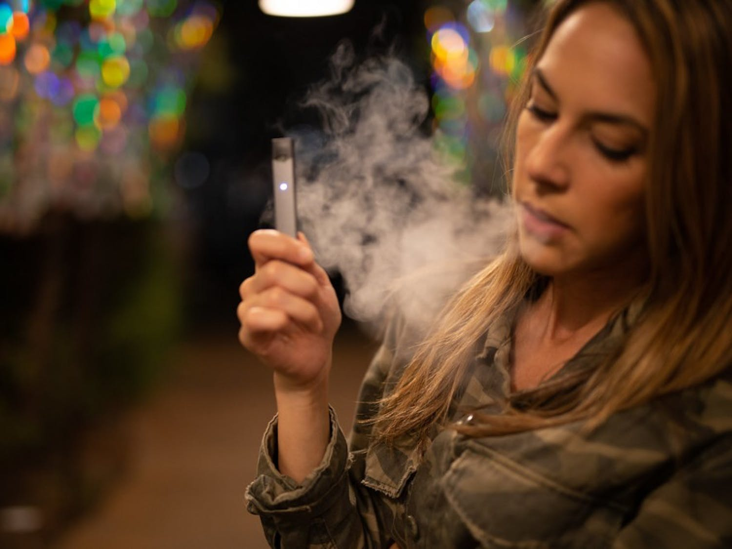 Rebecca takes an extra long hit from her beloved Juul, something she will never again take for granted.