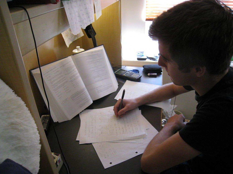 Drew Boyd completing basketball team's homework