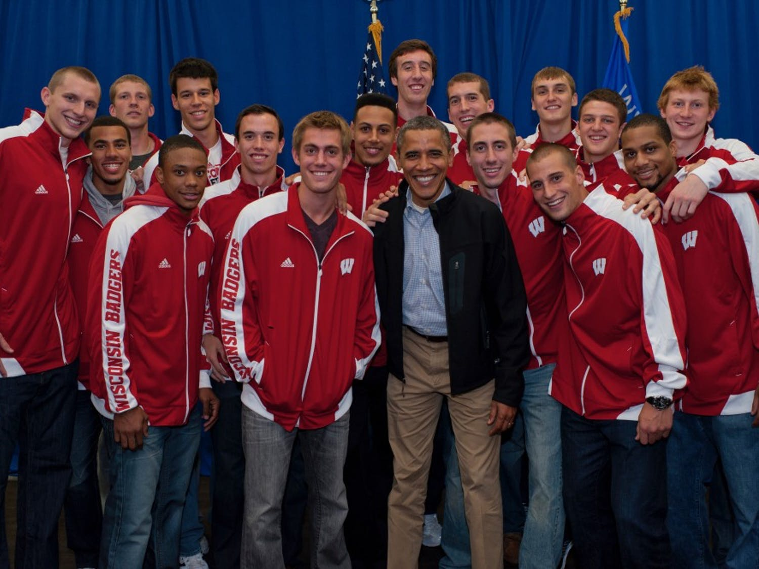 The 2012 basketball team poses for a picture with Obama before his speech on Bascom Hill.
