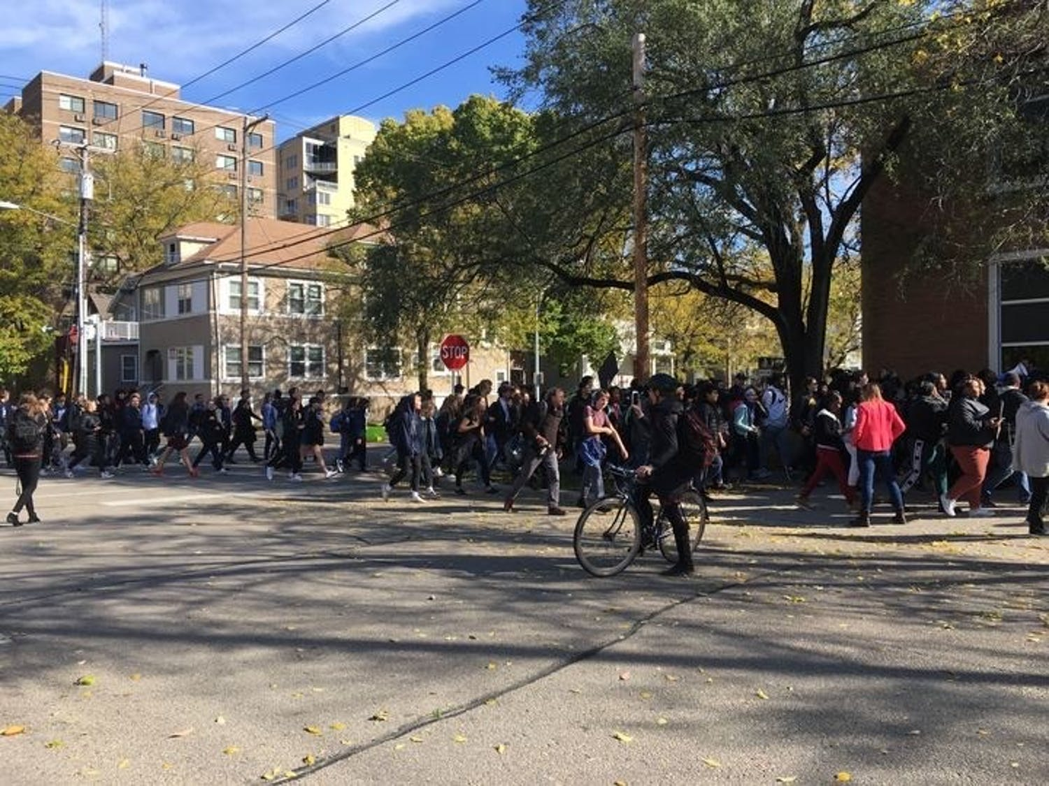 In light of school guard Marlon Anderson's termination –– a controversial implication of zero-tolerance policies –– West High School students protested outside of the MMSD Doyle Administration building.